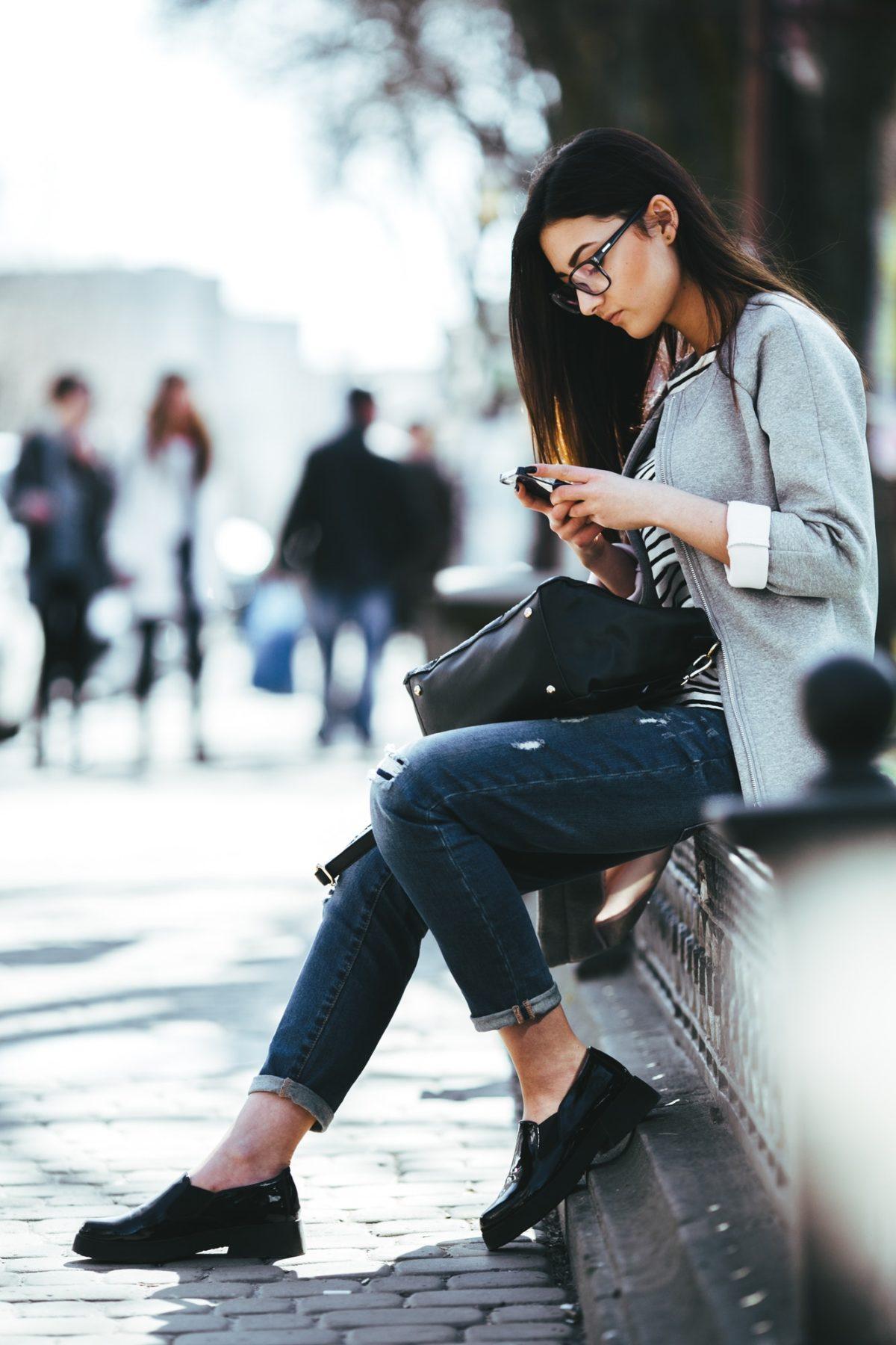 Beautiful fashion model in glasses sits