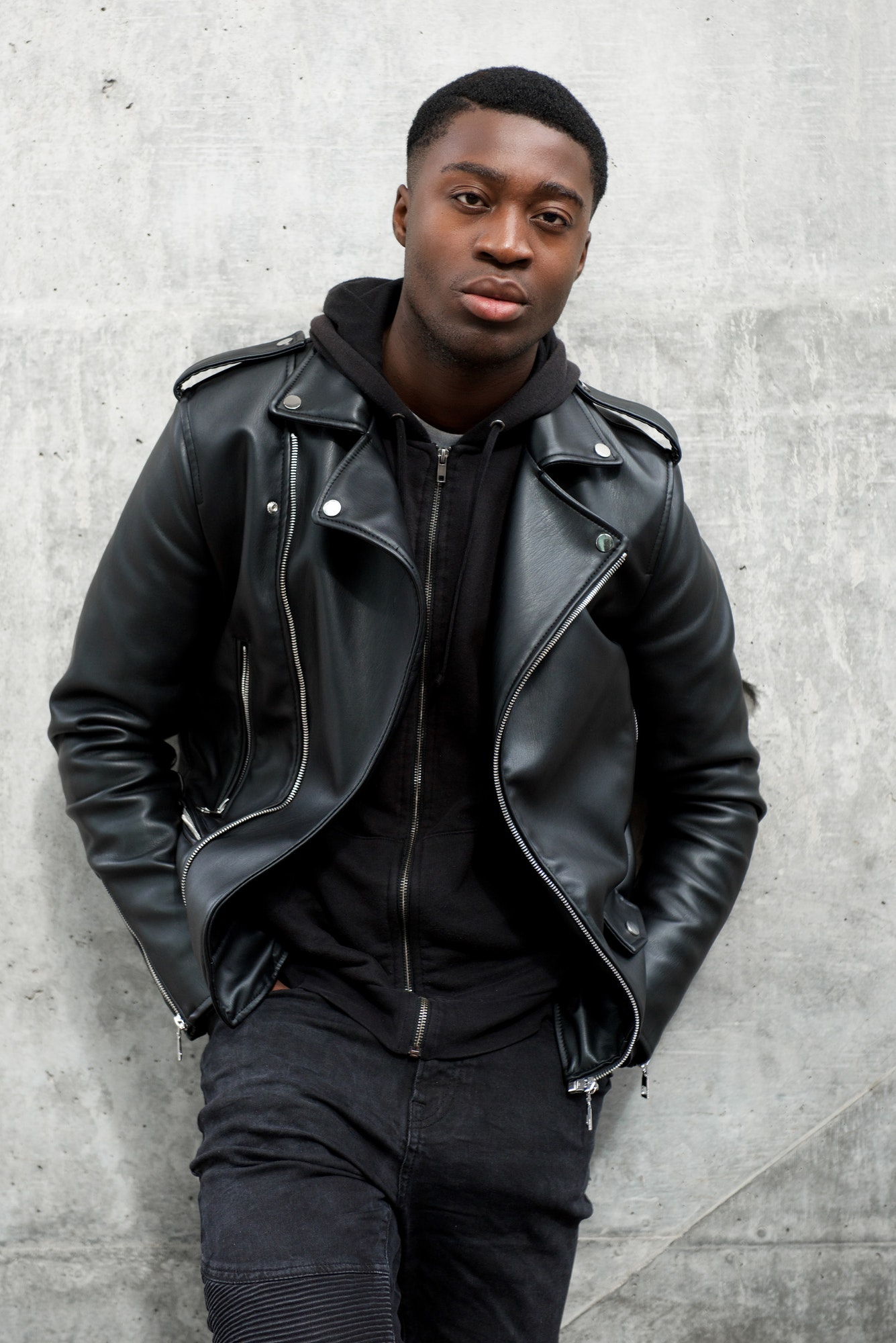cool young black man with leather jacket