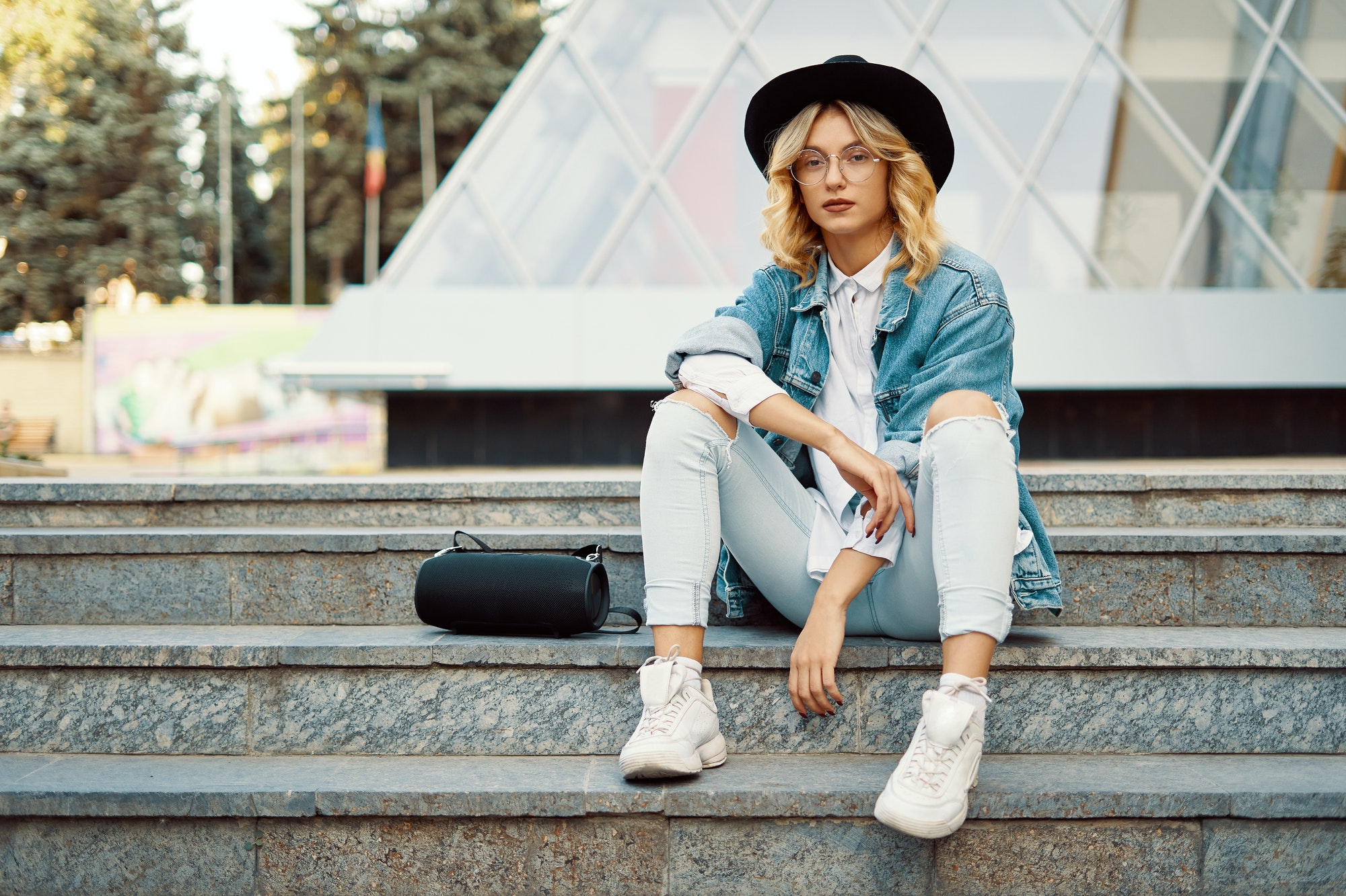 Fashionable modern woman with glasses in the city