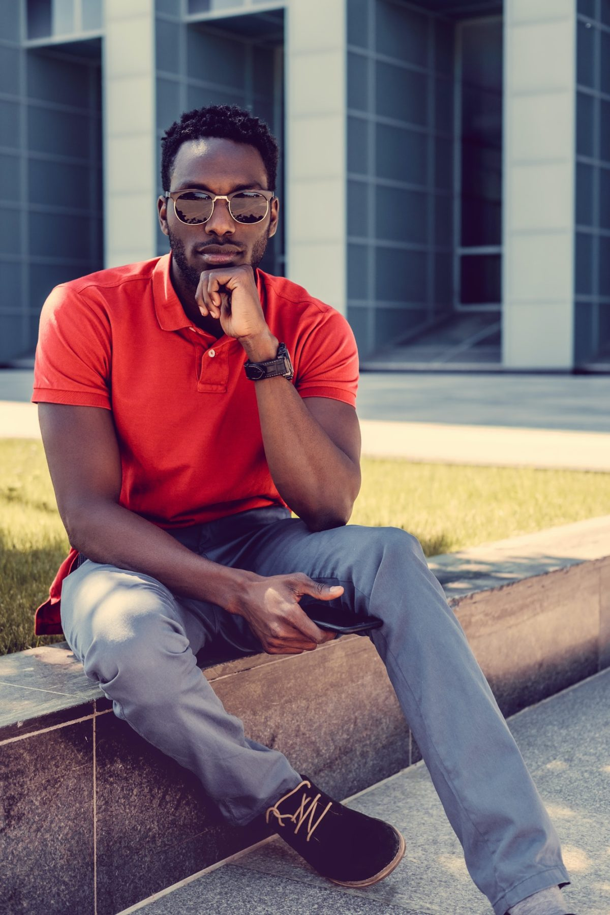 Portrait of serious black man in a red t shirt.