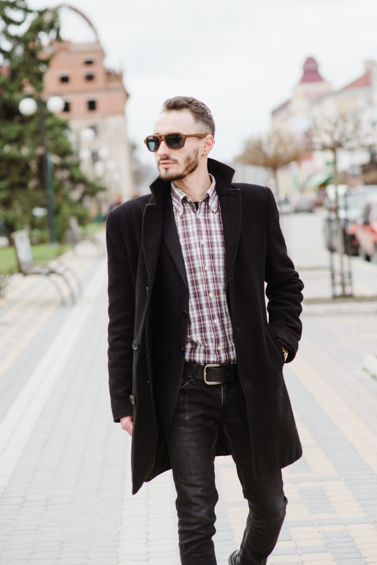 Young stylish man walking in sunglasses