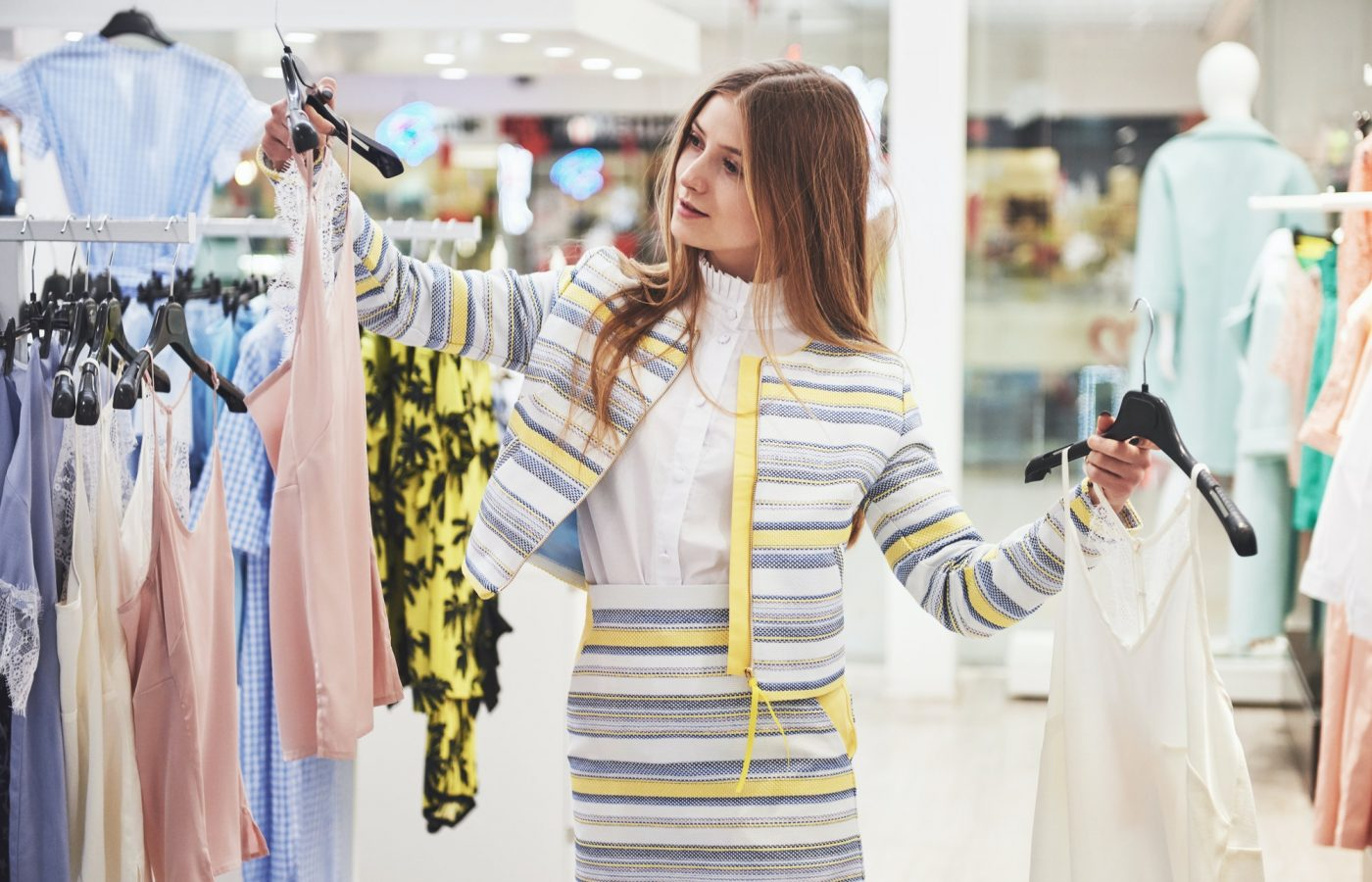 sale, fashion, consumerism and people concept - happy young woman with shopping bags choosing